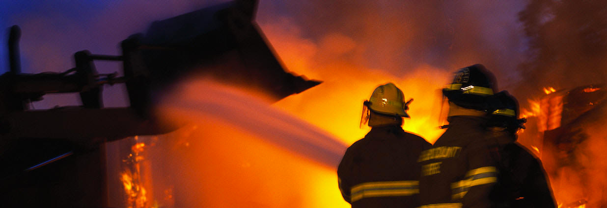 Fire risk assessor and a hotel manager have both been jailed for eight months for fire safety offences